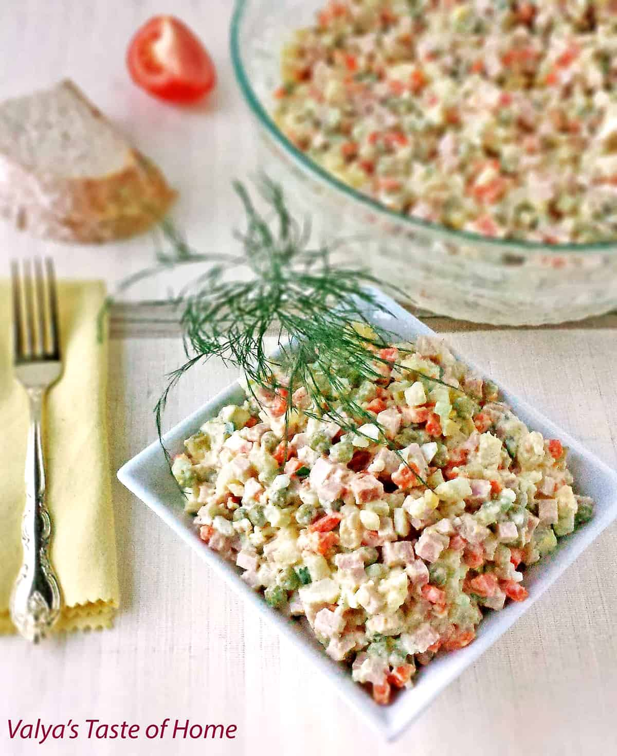 This Classic Potato Salad Recipe (Olivie) is a must-have on any holiday table. It's very easy to make, very hearty, and craveable. Just cook some veggies and eggs, chop them up, add mayo, salt, and pepper and you have a very delicious salad.