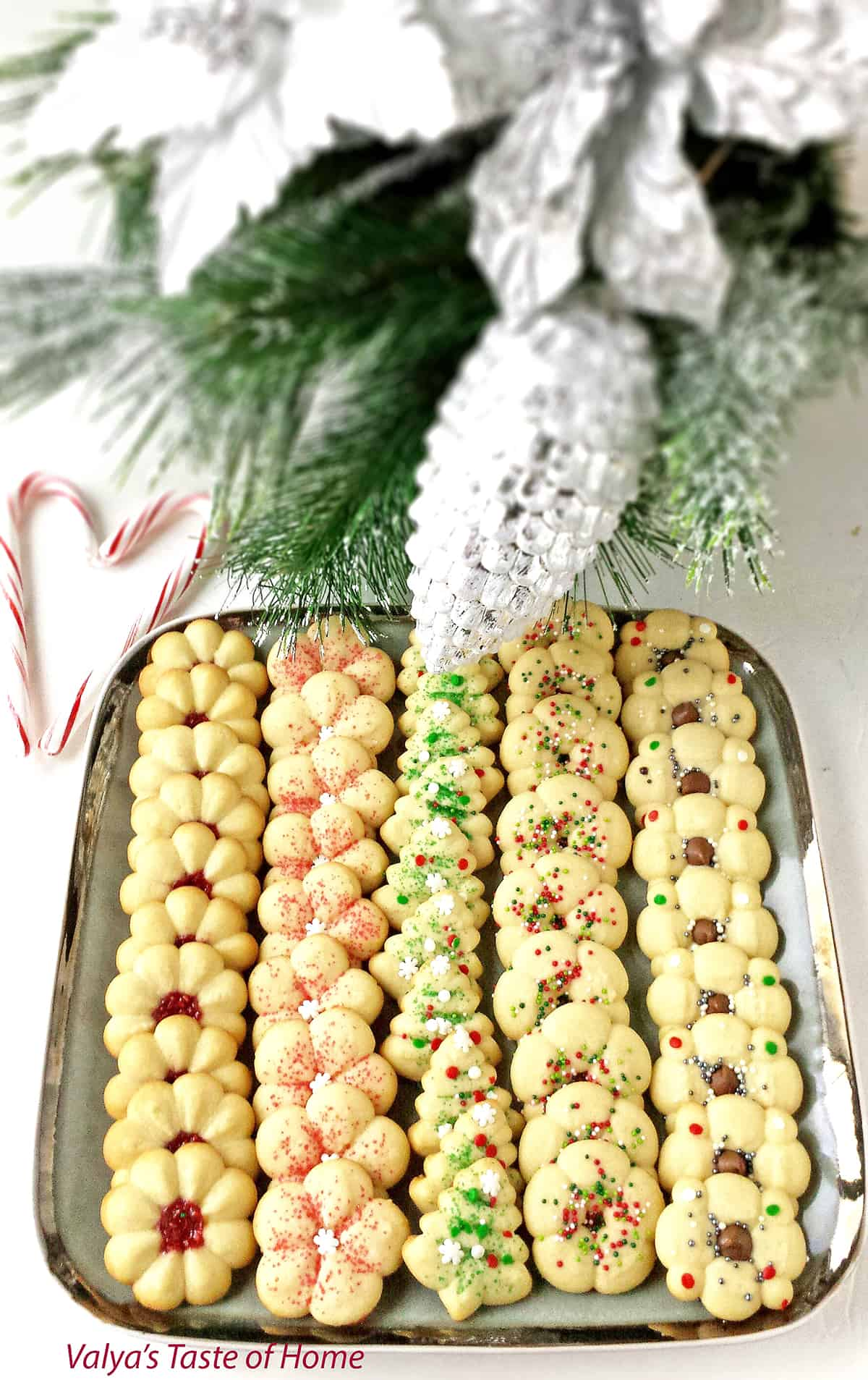 What holiday would dessert plate be complete without these incredible Christmas Spritz Cookies? These may be the most popular, classic Christmas cookies you'll ever make. I have been making these Spritz cookies for years and they've become a traditional Christmas cookie recipe in our family.