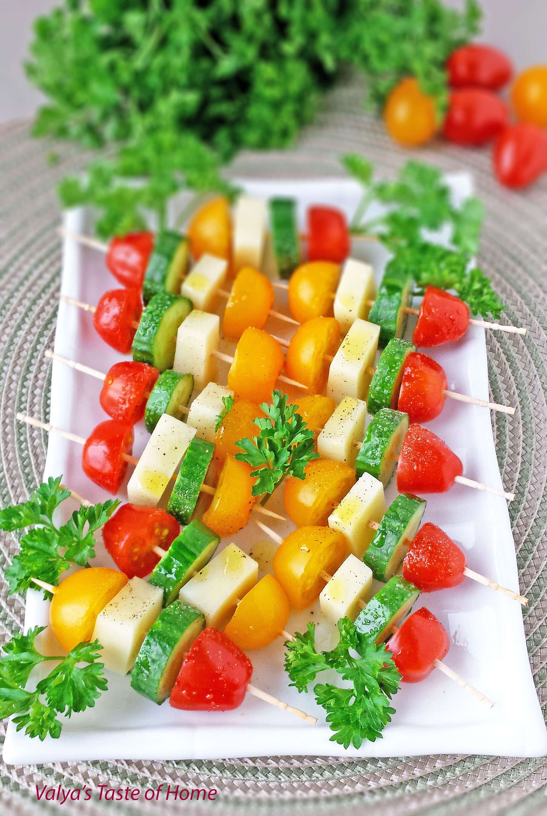 These delightful and healthy Tomatoes Cucumber and Mozzarella Cheese Kabob Appetizers seasoned with salt and pepper, and drizzled in olive oil are so easy to make and tastes absolutely delicious. #kabobappetizers #veggiekabobappetizers #partyfriendly #valyastasteofhome