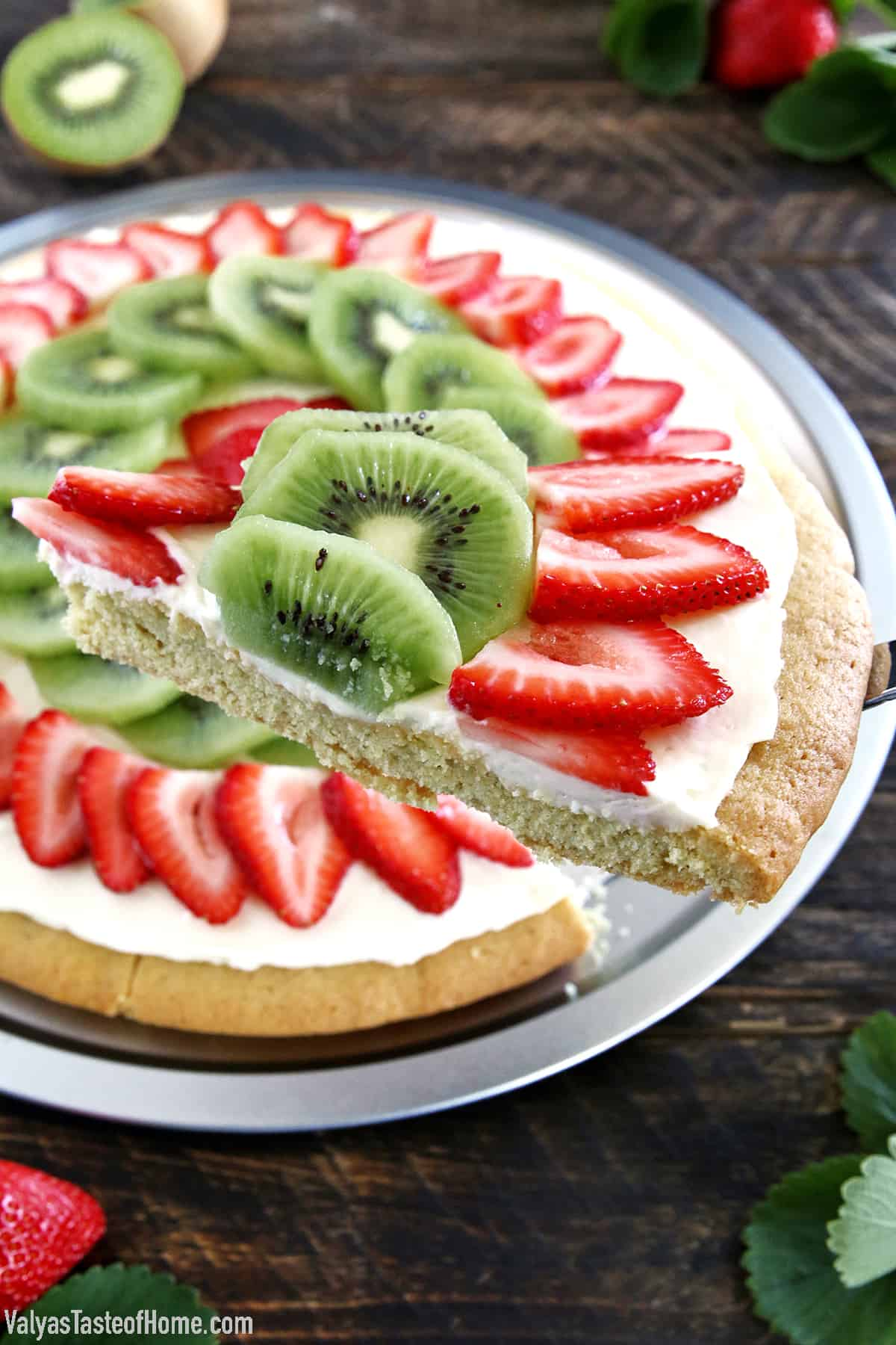 Another kid-friendly project is up again! Of course, there are lots of different fruit you can put on dessert pizza, but strawberry and kiwi is our family's absolute favorite combination, and this Strawberry Kiwi Dessert Pizza is my kid's favorite dessert pizza.