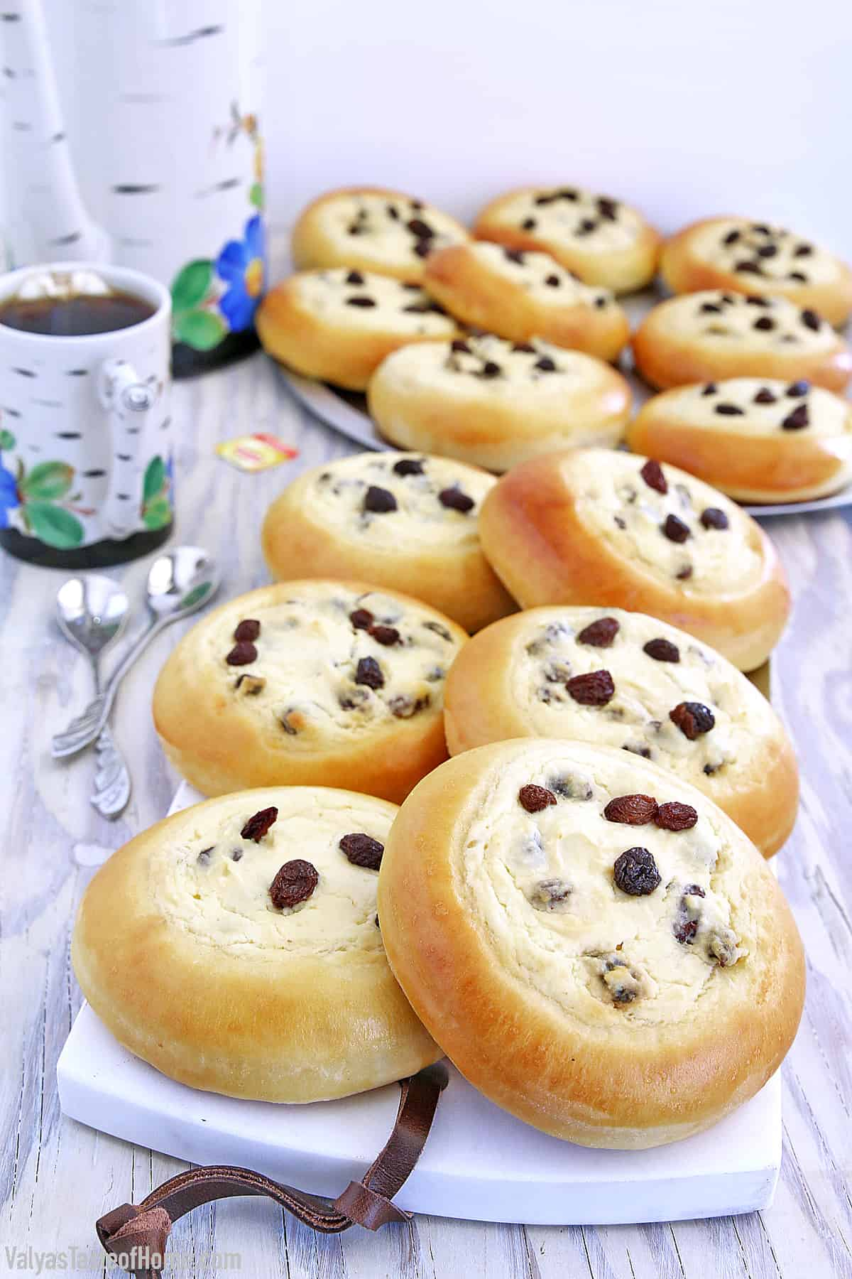 These Sweet Buns with Farmers Cheese and Raisins are made with a slightly sweet yeast dough that is topped with sweet farmer's cheese filling and is very popular in Eastern Europe.