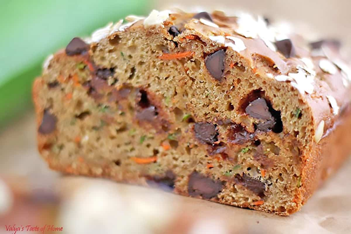 We are overloaded with carrots and zucchini in my garden this year. So, I thought I'd play with them and create some recipes. I literally tossed all ingredients together in just a few minutes is how this Greek Yogurt Carrot Zucchini Bread with Dark Chocolate Chip was created.