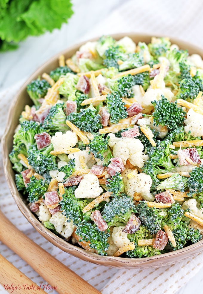 This Broccoli and Cauliflower Salad Recipe is one that's so easy to prepare but tastes flavorful, refreshing and satisfying. One noteworthy tip is to soak the broccoli in freshly-squeezed lemon juice for extra flavor and crispness. It will also keep the broccoli from losing that bright green fresh color. Bacon and freshly grated cheese give the additional boost in taste that kids love.