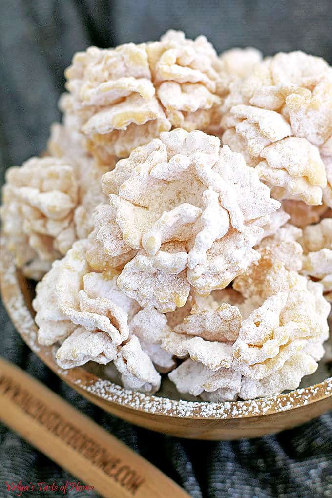 """These Pom-Pom Cookies Recipe is traditionally known as """"Hvorost"""" in Russian or """"Hrustiki"""" in Ukraine. They are not only easy and delicious but also make a gorgeous dessert décor! There is plenty to celebrate in the near future."""