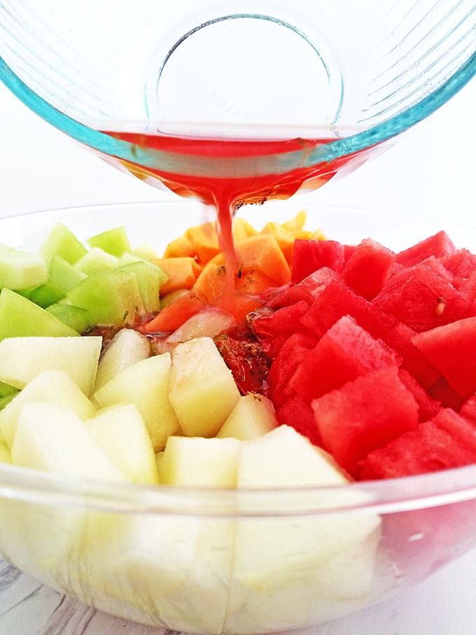 What can be better than a bowl of chilled Melon Fruit Salad with Honey Lime and Watermelon Juice Dressing on a hot summer day? While you shouldn't abandon your water consumption, a nice bowl of this refreshing watery fruit with a touch of sweetness is sure to hit that thirsty and sweet spot. It's a brilliant addition to any outdoor party.
