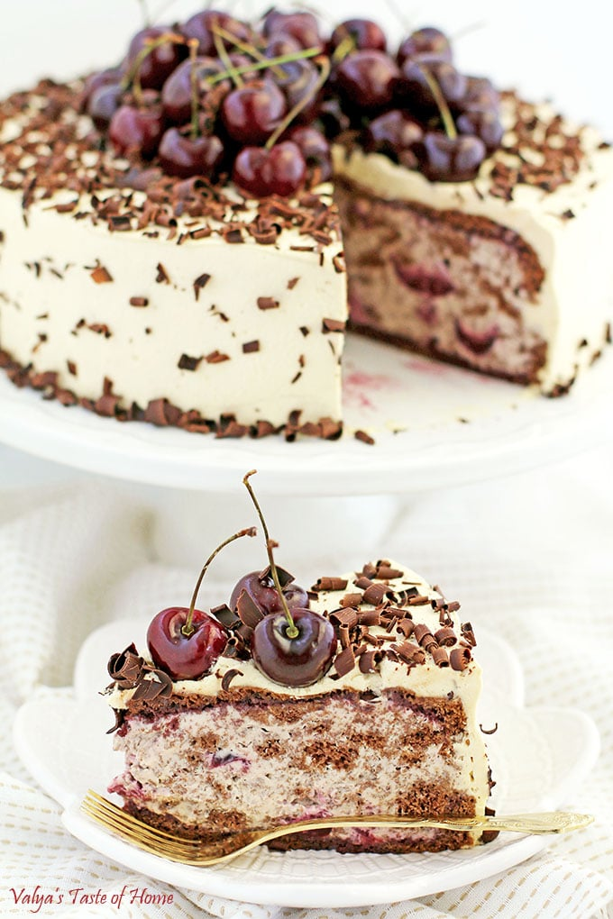 This Drunken Cherry Cake Recipe is loaded with two pounds of lightly cooked cherries, topped with a pound of fresh cherries, caramel cream, and fluffy chocolate cake sponge, and finally sprinkled with shaved best-tasting organic chocolate, it's fair to say that self-control takes a little more effort around this exquisite goodness. #drunkencherrycake #freshcherries #caramelcream #valyastasteofhome