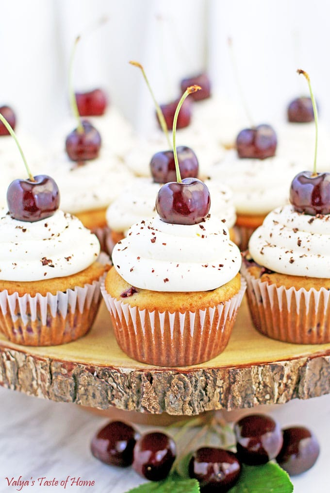 It's a cherry season and flying by way too fast! I absolutely love cherries. So what does all that add up to? Of course, another Cherry Vanilla Cupcakes Recipe in the form of delicious single-serving dessert. These cupcakes are not only beautiful but incredibly tasty, fluffy, moist, light, and loaded with fresh cherries.