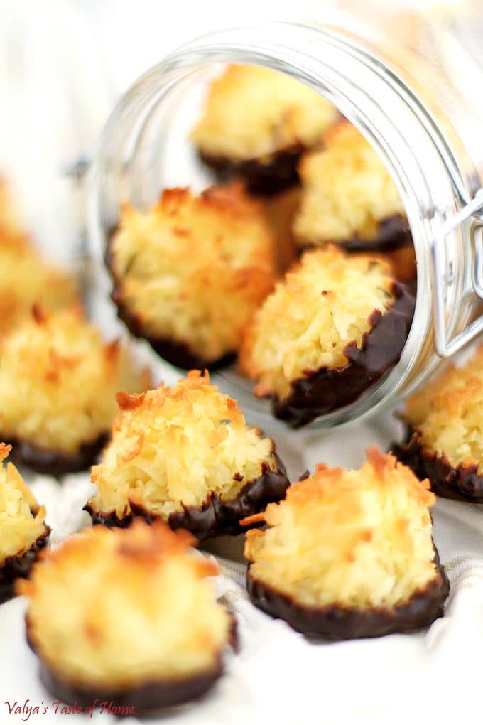 For all the coconut lovers out there, great news! These Chocolate Dipped Coconut Macaroons are deliciously packed all-coconut cookies you will love. It's super easy to make, and perfect for students. You don't even need fancy equipment; a simple hand mixer will do the job well! #coconutmacaroons #chocolatedippedcoconutmacaroons #cookies #valyastasteofhome