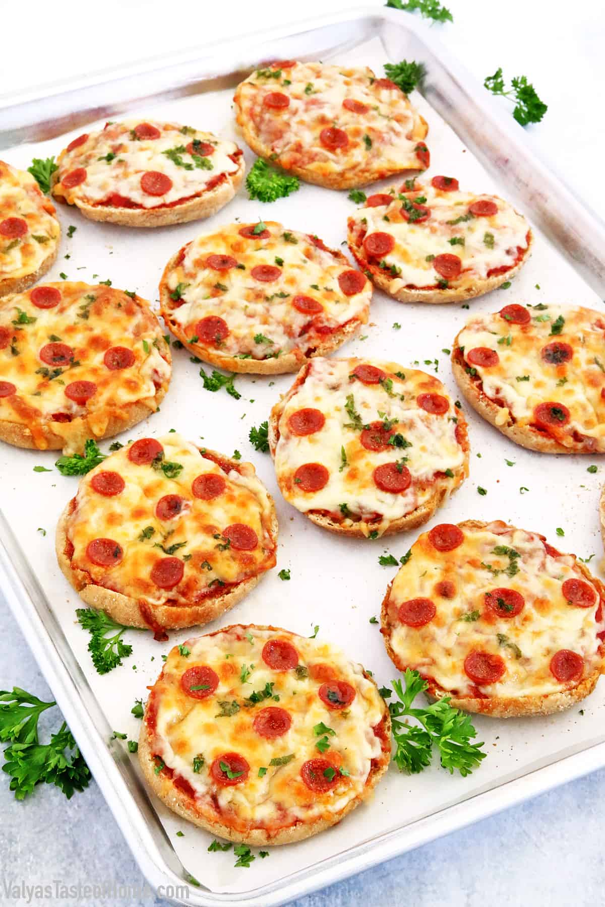 These English Muffin Mini Pepperoni Pizzas is a great project for the kiddos. It takes just a few basic ingredients, but the little ones love making them. They feel like they cooked their own pizza!