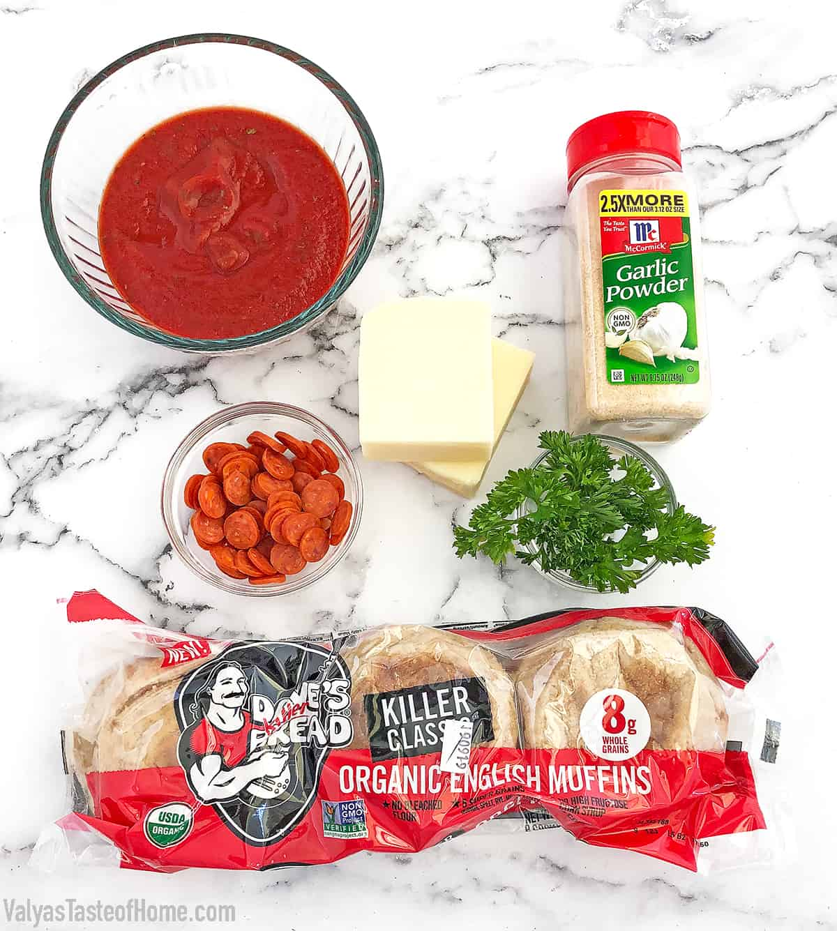 These English Muffin Mini Pepperoni Pizzas is a great project for the kiddos. It takes just a few basic ingredients, but the little ones love making them. They feel like they cooked their own pizza! #cookingwithkids #minipizzas #englishmuffinminipizzas #valyastateofhome