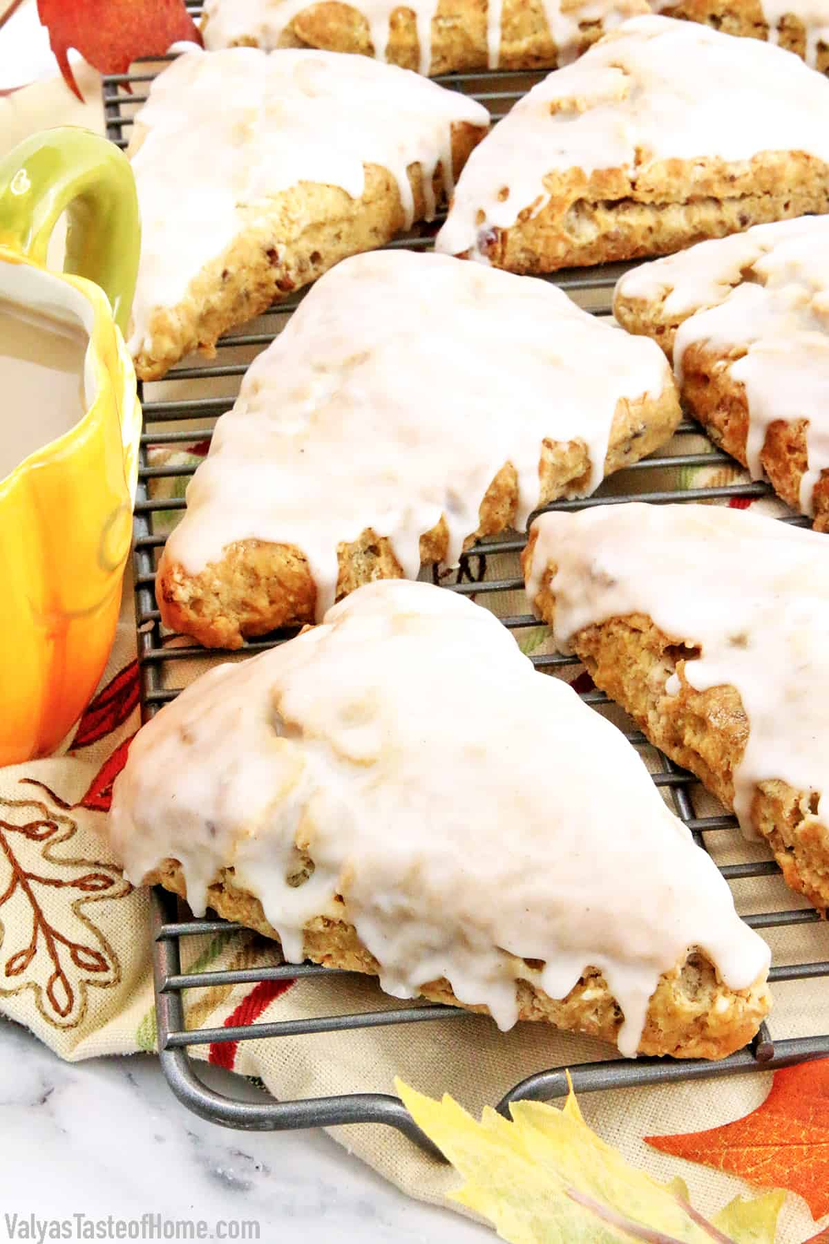 These Glazed Pumpkin Pecan Scones are soft, flaky, buttery, and bursting with cinnamon and pumpkin flavors. They are super simple to make but very delicious fall treat that is so much loved in my family. #pumpkinscones #glazedpumpkinpecanscones #breakfast #easyrecipe #valyastasteofhome