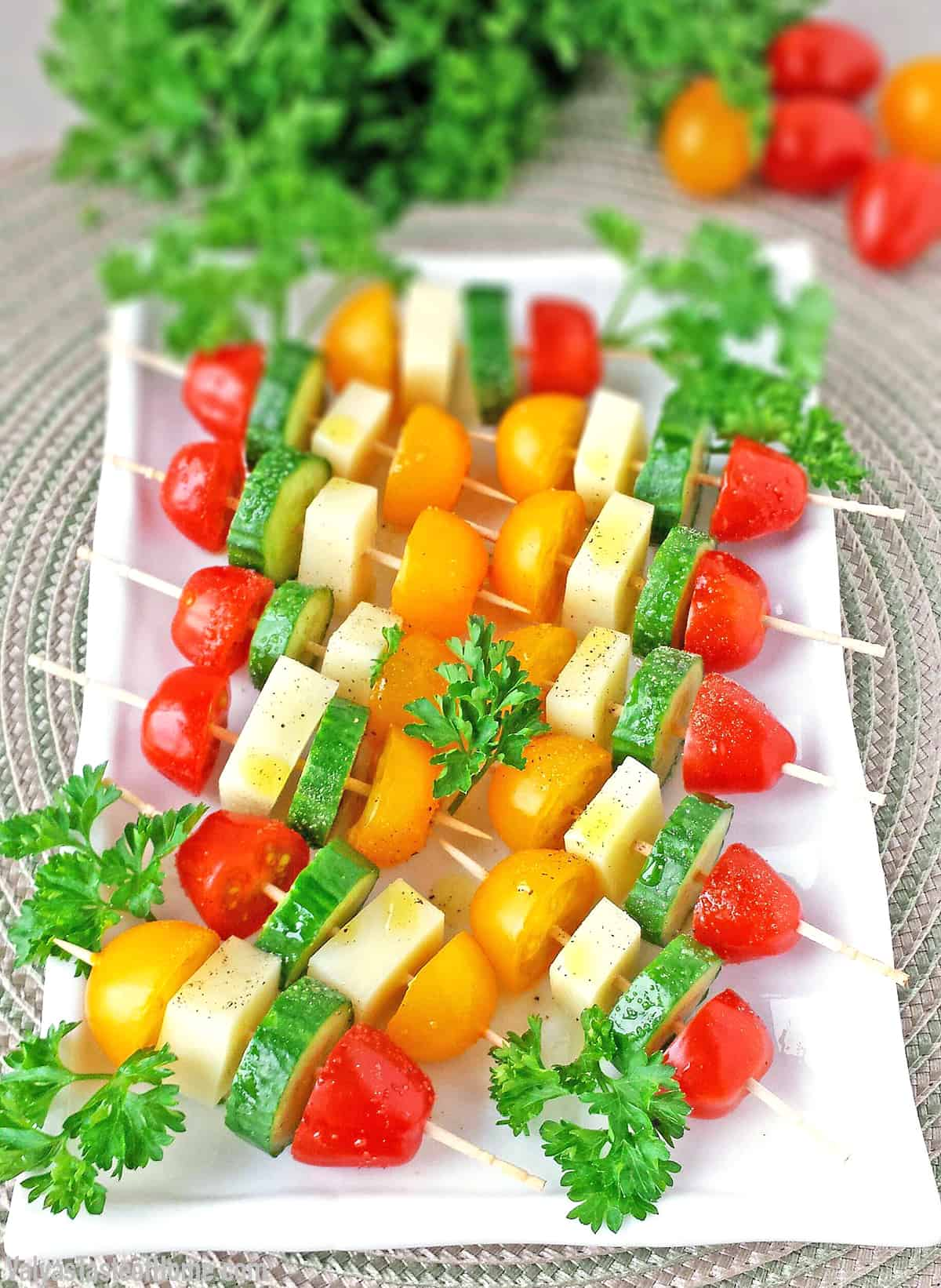 This delightful Tomato Cucumber and Mozzarella Cheese Kabob Appetizers seasoned with salt and pepper and drizzled in olive oil are so easy to make and tastes absolutely tasty.