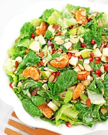 This bright and colorful Pear, Pomegranate, Mandarin Winter Salad with Homemade Ranch Dressing and some of the winter harvested fruit is so scrumptious! #wintersalad #veggiewintersalad #easysaladrecipe #valyastasteofhome.com