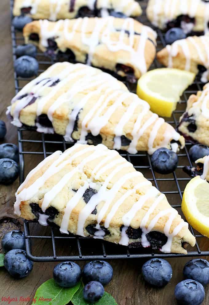 These Lemon Blueberry Scones with Lemon Glaze are light, moist, and fluffy. They have just the right amount of sweetness, drizzled with lemony goodness, which makes them taste simply scrumptious! Scones make a perfect breakfast, brunch, or an afternoon coffee break.