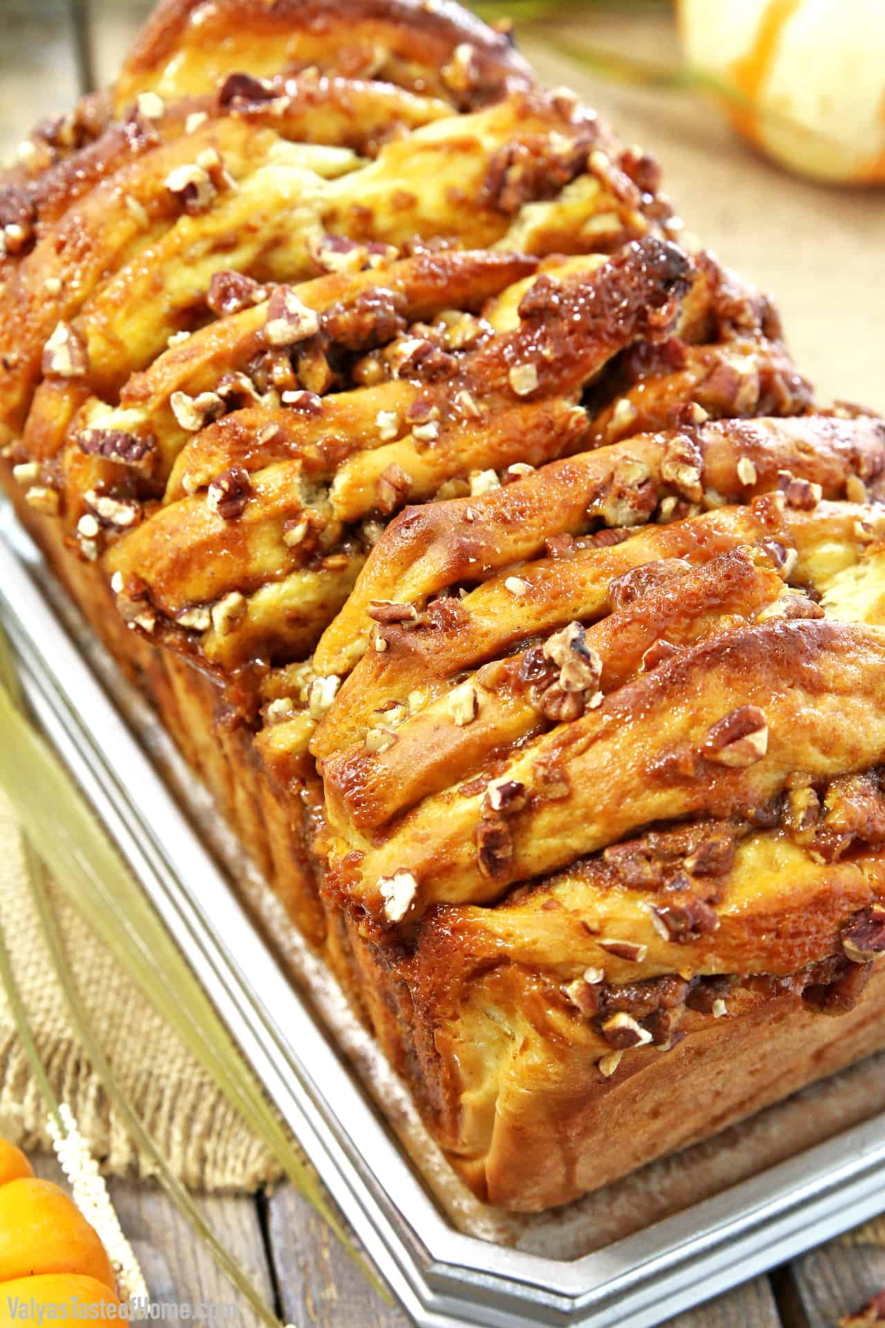 The name of this treat, Pumpkin Pull-Apart Bread with Pecans and Caramel, pretty much covers it! Filled with wonderful flavors we all love about Fall, it's sure to satisfy your sweet cravings.