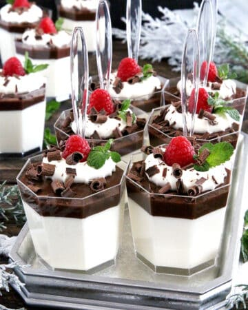 An amazingly delicious creamy mousse-like base, covered with a thin layer of cacao-jelly, topped with smooth whipping cream, and dressed with berries and shaved dark chocolate.