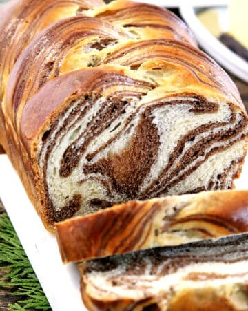 This Easy Soft and Fluffy Sweet Marbled Bread Recipe feature alluring swirls of vanilla and chocolate. Although it may look dizzyingly complicated it is actually super easy to make. Airy, light, and sweet aromatic bread, each slice with its own uniquely gorgeous design that looks hard to believe it's actually edible.