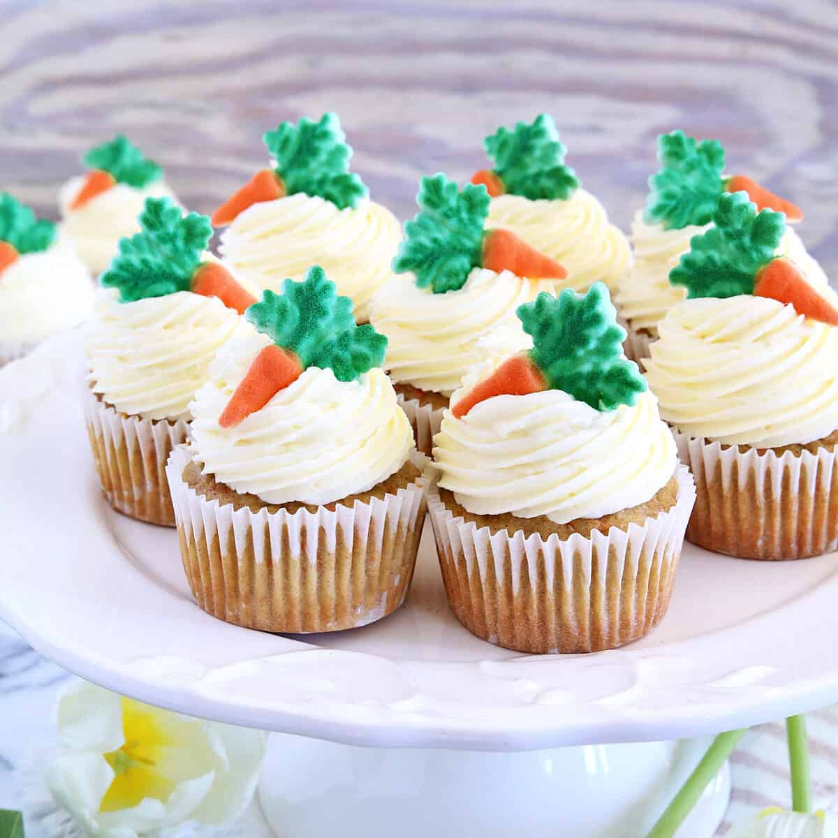 These The Best Carrot Cake Cupcakes are moist, fluffy, and spongy soft, delicious cupcakes you'll ever try. They are made completely from scratch, down to the freshly grated carrots, and topped with a generous swirl of the absolute best cream cheese frosting!