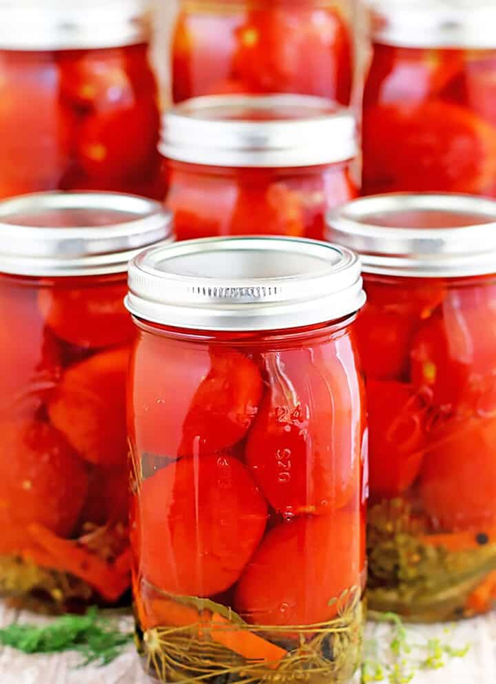I grew up canning fruits and vegetables with my mom and still enjoy doing it to this day. I've tried a few different blends in the past. This particular Canned Tomatoes Recipe is my aunt Lyuda's, and the one that takes the number one spot for me.