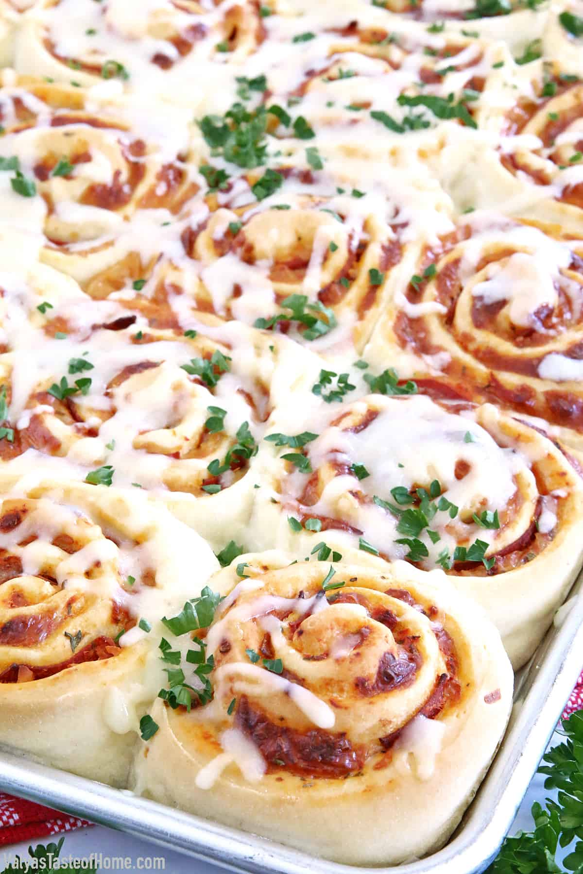 Move over, tiny pizza bites, because here come hearty Easy Pepperoni Pizza Rolls! This recipe is made with my popular super soft and chewy Homemade Pizza Dough, Homemade Pizza Sauce, loads of scrumptious turkey pepperoni, and mozzarella cheese. All rolled up into one amazingly tasty treat that is always a big hit at my house.